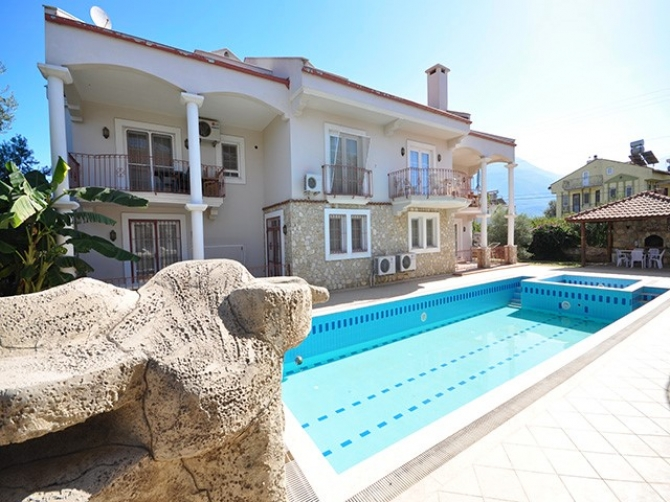 Duplex Apartment in Calis with Shared Pool and Garden.