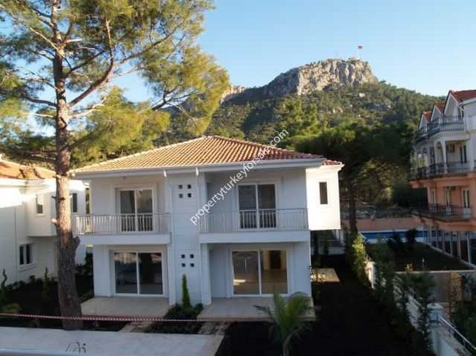 Villa Exterior and Mountain Backdrop