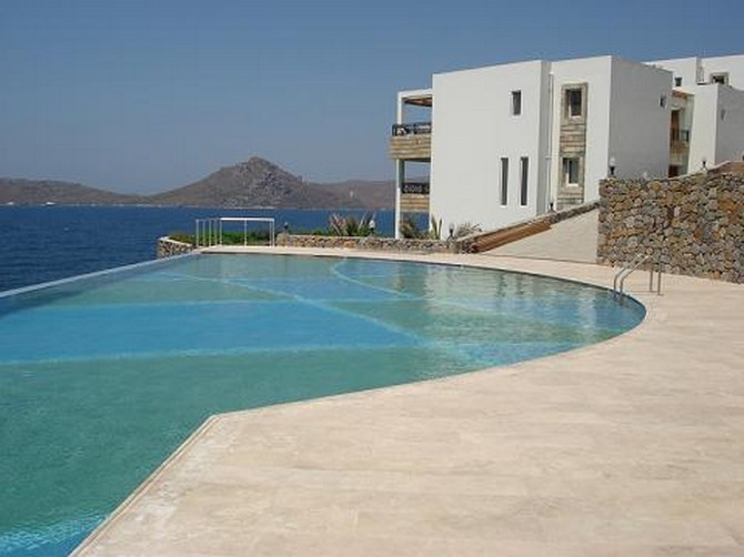 There is a large pool and beach platform