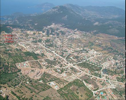 Birds eye view of Ovacik with Blue Lagoon in the distance